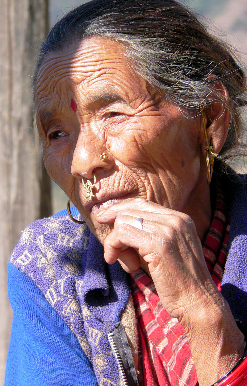 A Nepali Woman sitting under the sun